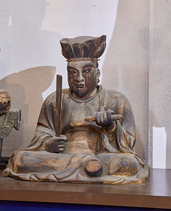 The wooden seated statue of the Great King Yama